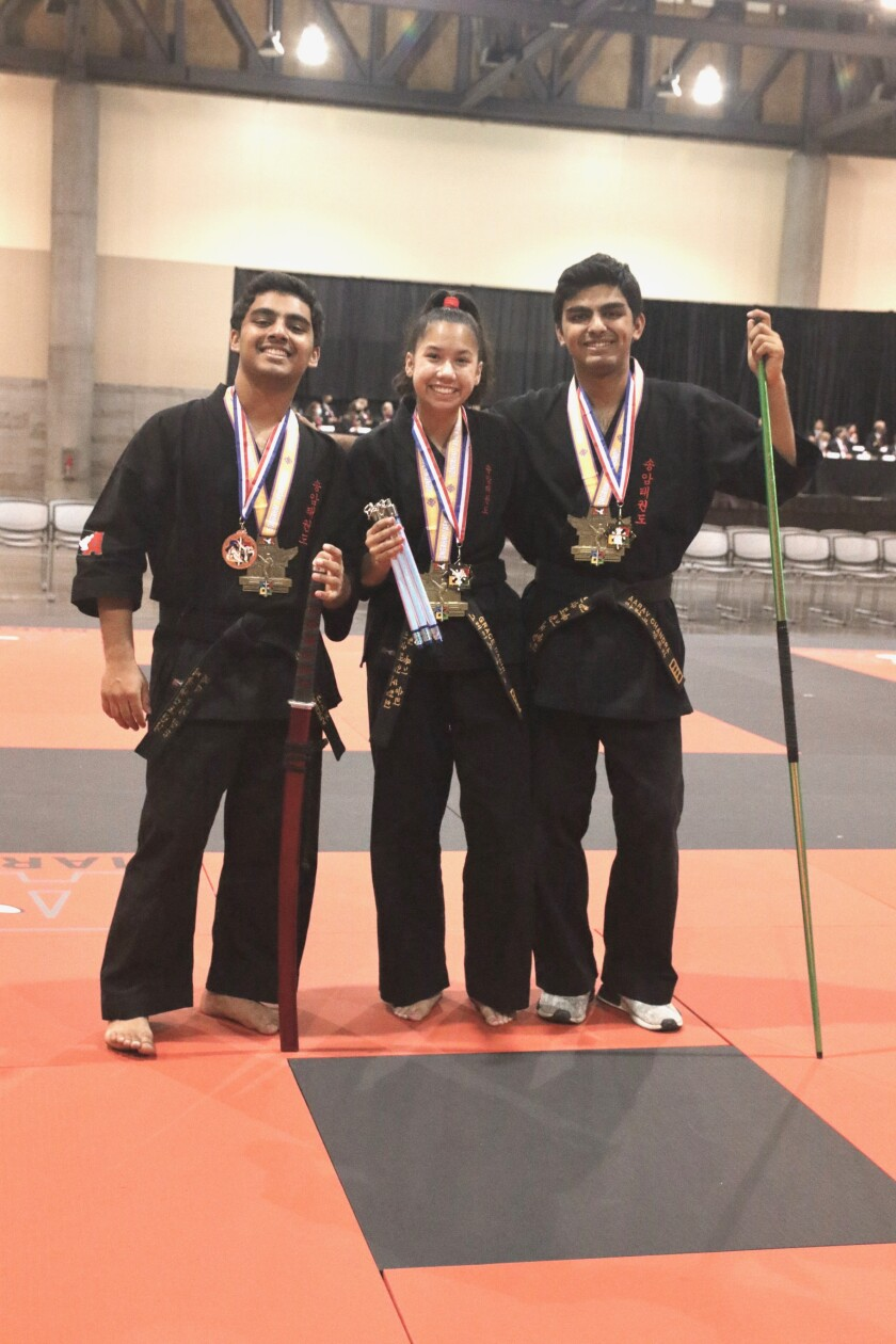Bishop's School students Advay Chandra, Grace Dabir and Aarav Chandra are tae kwon do medalists.