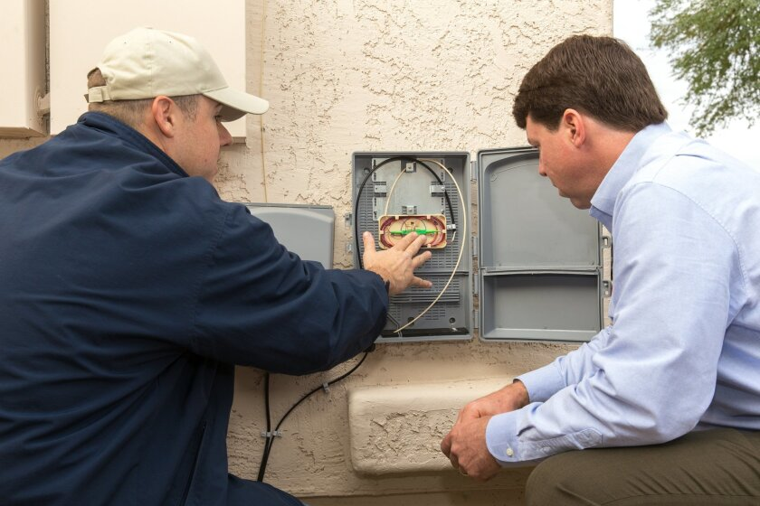Cox Communicaitons' technician ready a home in Phoenix for gigabit Internet service, which will become available in three new housing projects in San Diego.