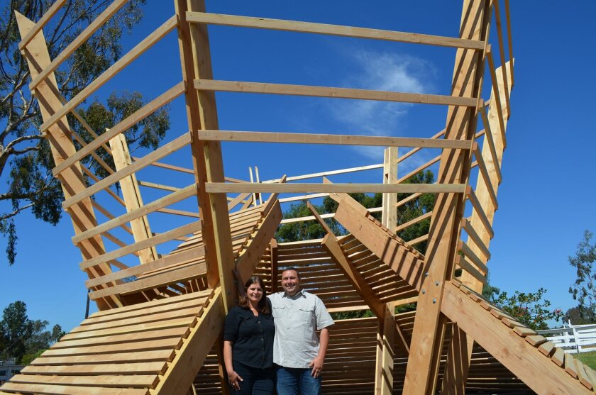 Married couple Chris and Sasha Varone stand in front of their plant-inspired sukkah. Building it gave them an appreciation for family, friends and shelter.