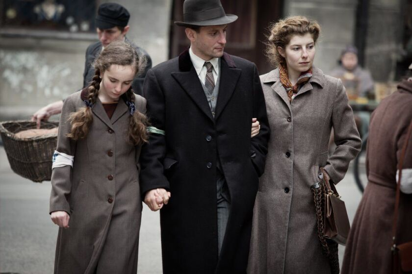 "Julia Lewenfisz-Gorka, Wojciech Zielinski and Marta Ormaniec portraying Ora, Abraham and Luba Lewin in a scene from the docu-drama ""Who Will Write Our History."""