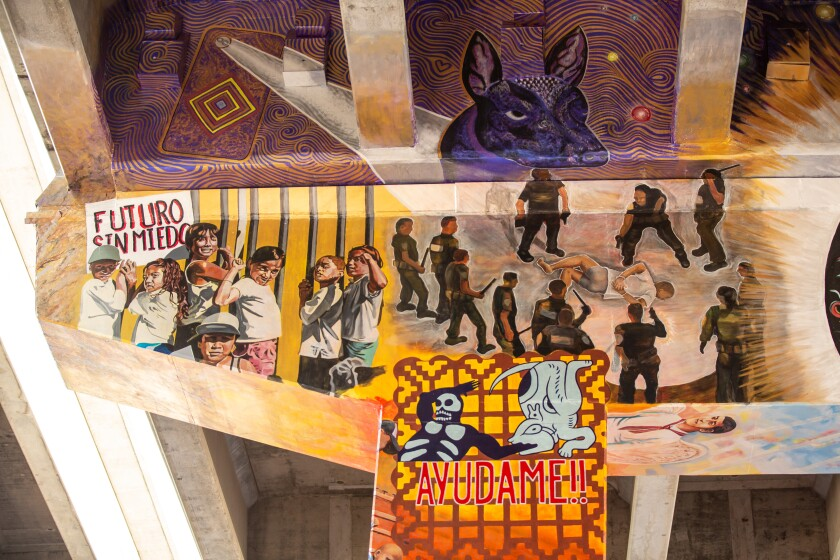 Artists unveil a new mural in Chicano Park that honors the memory of Anastasio Hernández Rojas.