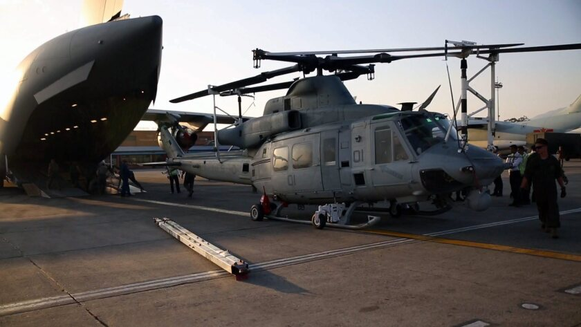A Marine UH-1Y Huey helicopter is unloaded from a transport plane at the airport in Katmandu, Nepal. A Huey has gone missing during the eartquake relief mission.