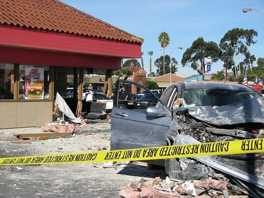 Damage to the car and the restaurant attest to the severity of Sunday's accident that left a man dead at an El Cajon Carl's Jr.