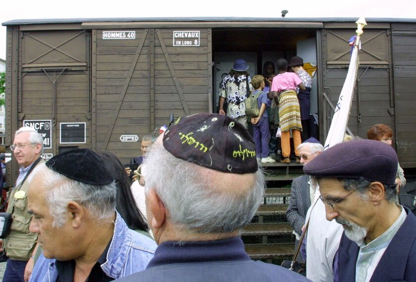 FILE - This Monday Aug. 20, 2001, file photo shows French Holocaust survivors gathering at the site of the former Drancy detention camp, north of Paris. Holocaust survivors and family members in the U.S., Israel and elsewhere can now apply for compensation from a $60 million fund for those deported