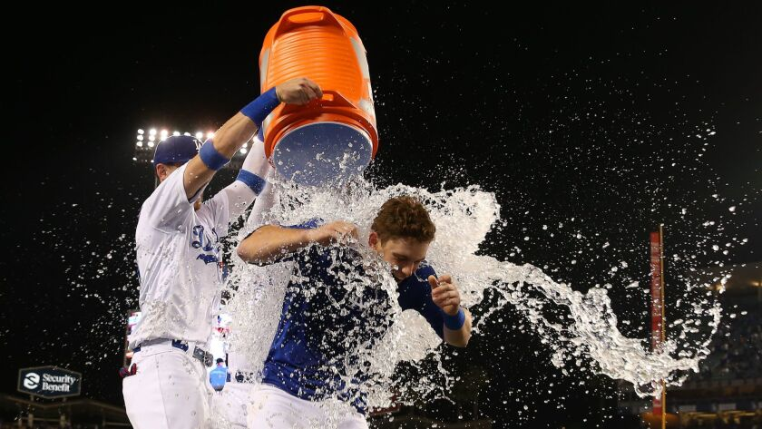 Dodgers catcher Will Smith is doused by teammates Cody Bellinger and Joc Pederson after hitting a walk-off homer against hte Phillies on June 1.
