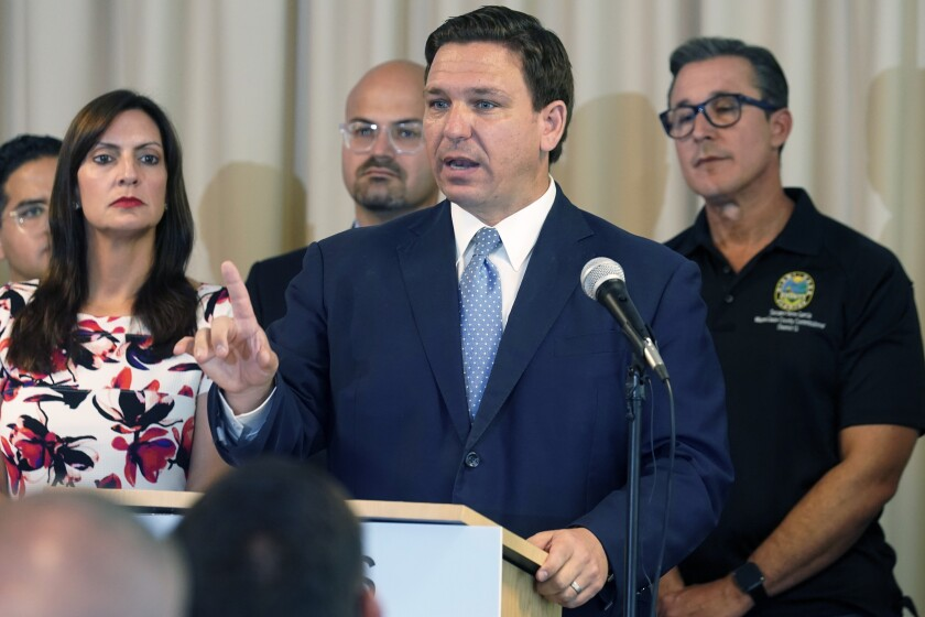 """FILE - In this Tuesday, Aug. 10, 2021 file photo, Florida Governor Ron DeSantis answers questions related to school openings and the wearing of masks in Surfside, Fla. Florida's new """"anti-riot"""" law championed by Republican Gov. Ron DeSantis as a way to quell violent protests is unconstitutional and cannot be enforced, a federal judge ruled Thursday, Sept. 9, 2021.(AP Photo/Marta Lavandier, File)"""