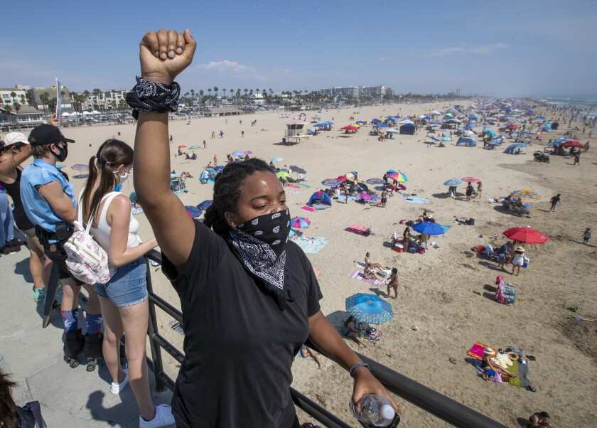 Black Lives Matter supporter Mari Drake of Los Angeles joins protesters on the Huntington Beach Pier.