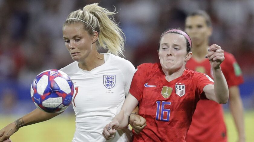 England's Rachel Daly, left, challenges for the ball with United States' Rose Lavelle during the Wom
