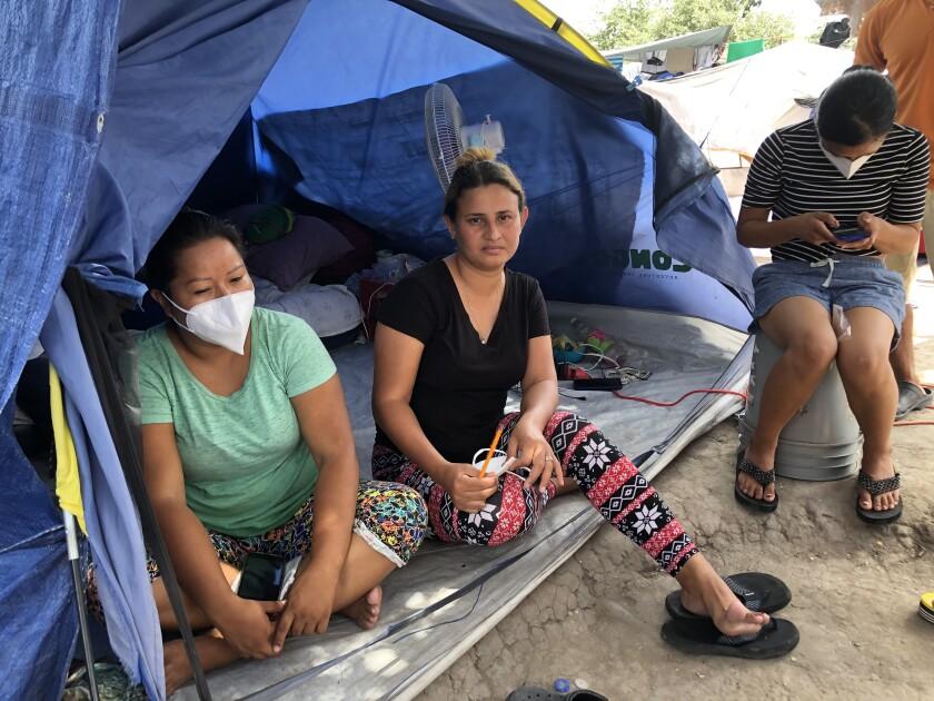 Honduran asylum seeker Lesly Pineda, center, at her tent in Reynosa, Mexico.