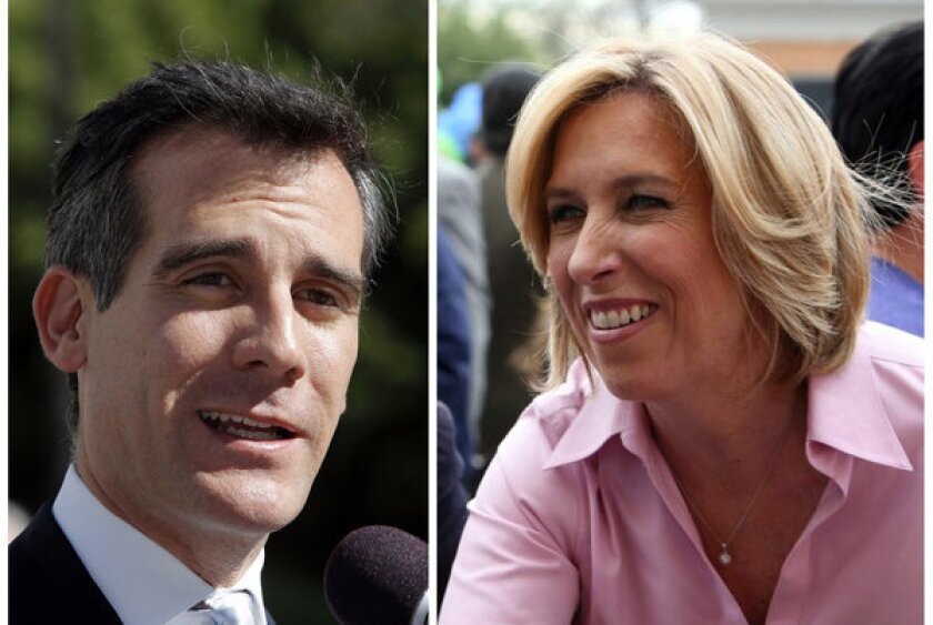 """Los Angeles mayoral candidate Eric Garcetti, left, said he does not support increasing the minimum wage, currently $8, to $15. Allies of his rival, Wendy Greuel, are telling voters that Greuel would try to raise the minimum wage to $15 per hour if she were elected mayor, though Greuel said: """"I don't know if $15 for minimum wage is what we would see here in Los Angeles."""""""