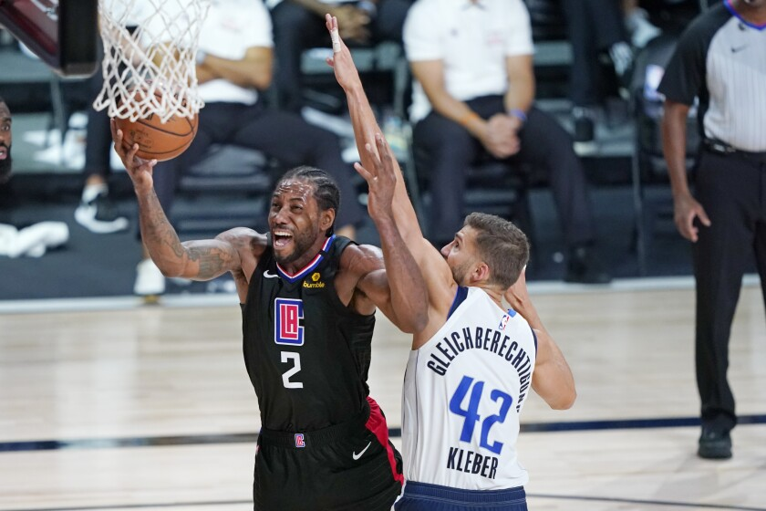 Kawhi Leonard (2) and the Clippers will try to bounce back in Game 3 against Maxi Kleber and the Dallas Mavericks on Friday.