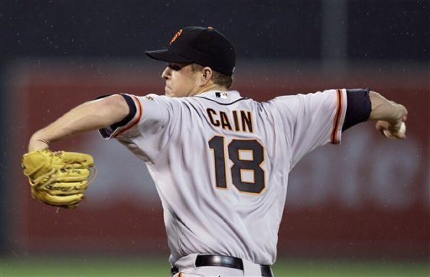San Francisco Giants' Matt Cain works against the Oakland Athletics during the second inning of an exhibition baseball game Tuesday, April 3, 2012, in Oakland, Calif. (AP Photo/Ben Margot)