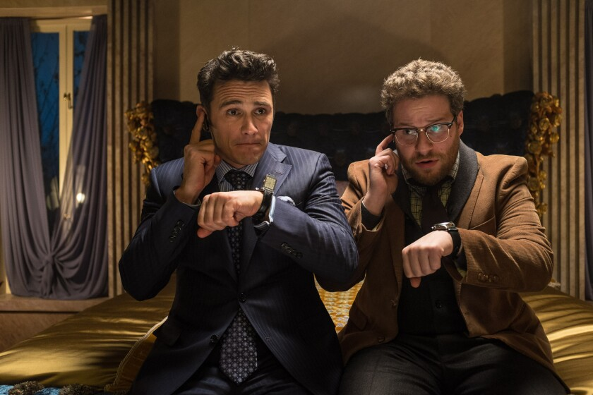 "James Franco, left, and Seth Rogen star in Sony Pictures Entertainment's ""The Interview."" A note claiming to be from a hacker group Monday demanded that the studio not show the film."