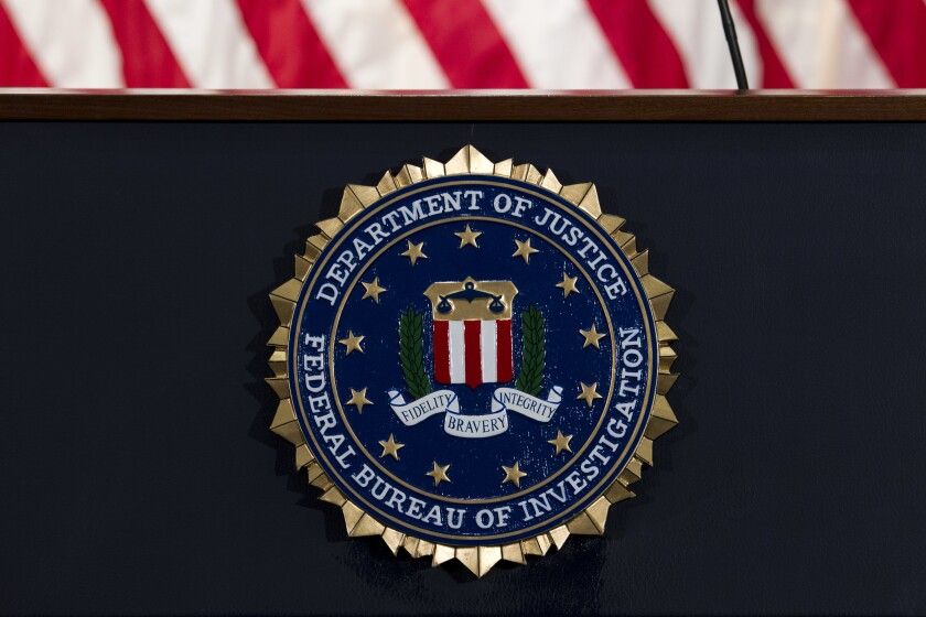 "FILE - In this June 14, 2018, file photo, the FBI seal is seen before a news conference at FBI headquarters in Washington. The U.S. government on Tuesday, Jan. 5, 2021, said a devastating hack of federal agencies is ""likely Russian in origin"" and said the operation appeared to be an ""intelligence gathering"" effort. The assessment was disclosed in a rare public statement from the FBI and other investigative agencies. (AP Photo/Jose Luis Magana, File)"