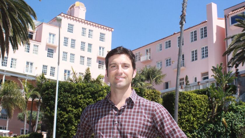 La Jolla resident Justin Maletic in front of the La Valencia Hotel, the inspiration for a piece of a