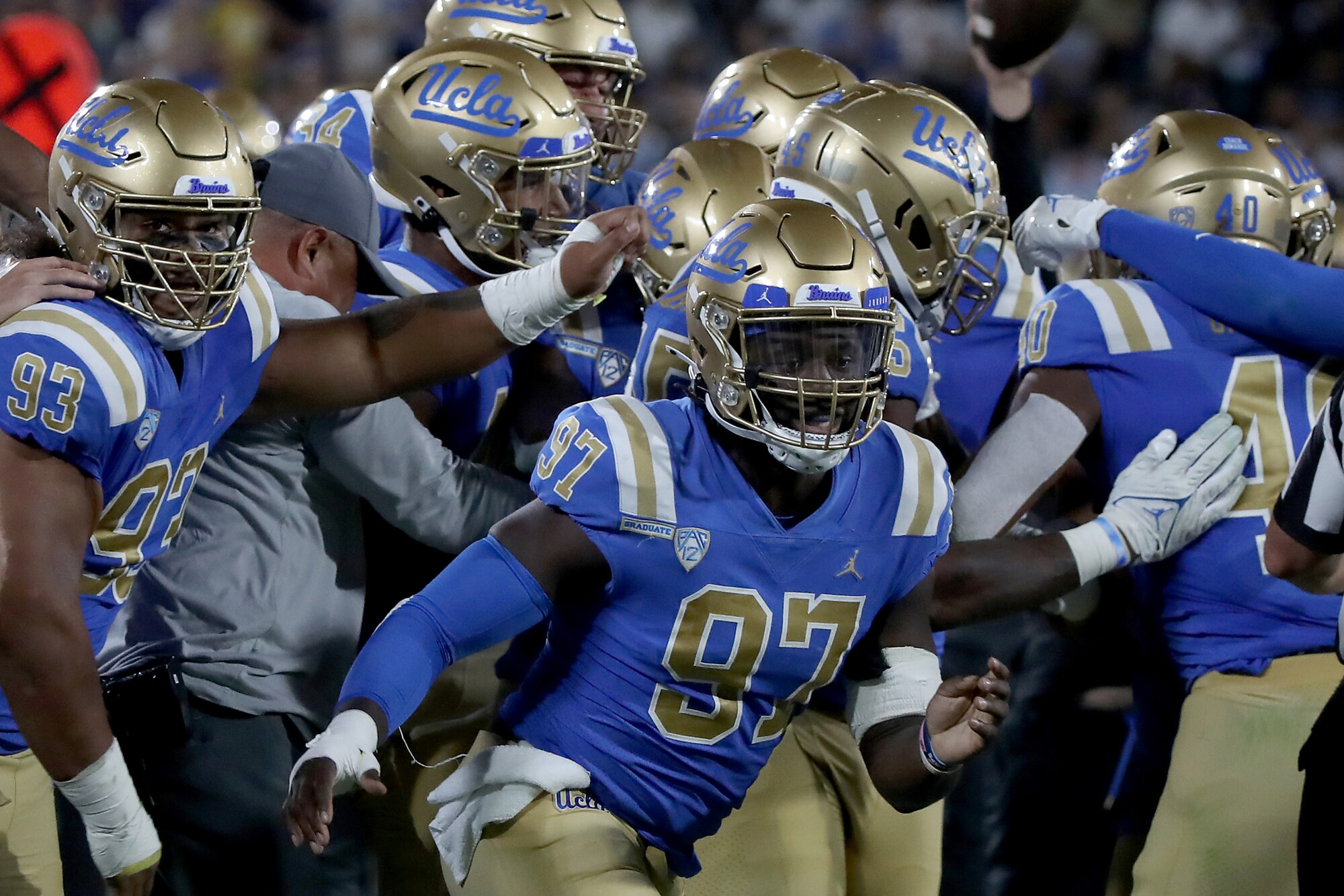 UCLA players celebrate after forcing a turnover against LSU at the Rose Bowl on Sept. 4.