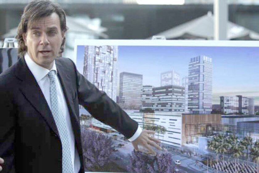 MIXED USE: Peter Lowy, head of Westfield America, shows an artist's rendering of what the Century City shopping center will look like. The center will offer retail, residential and office space.