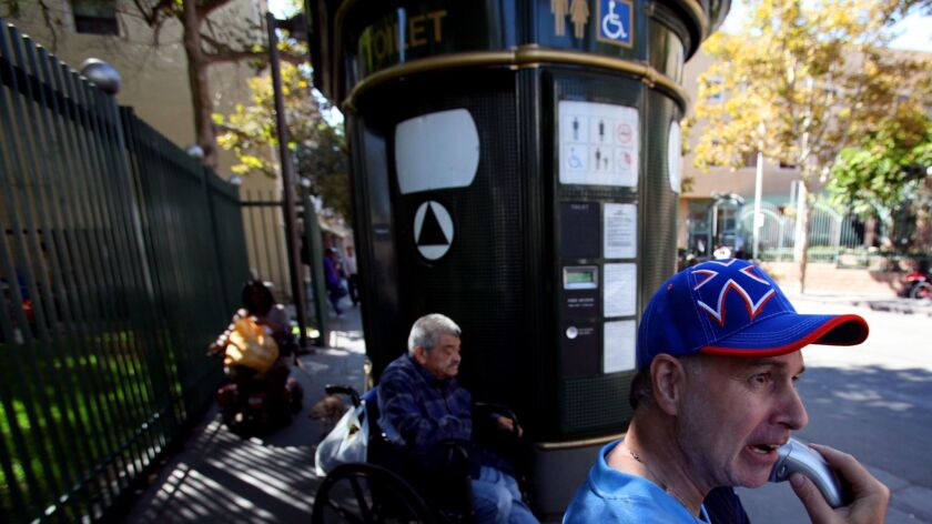 Men outside the public toilet at 5th and San Julian streets in downtown Los Angeles in 2013.