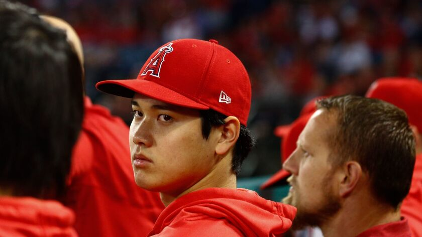 ANAHEIM, CALIF. - APRIL 04: Los Angeles Angels Shohei Ohtani, in the dugout during a game at Angel S