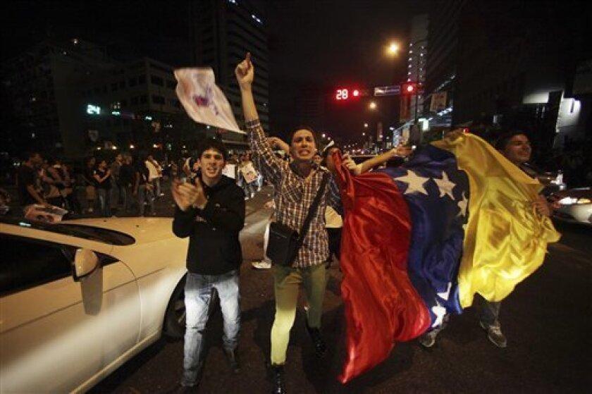 Supporters of former opposition presidential candidate Henrique Capriles wave a Venezuelan flag during a protest accusing Venezuela's re-elect President Hugo Chavez of electoral fraud in Caracas, Venezuela, Monday, Oct. 8, 2012. (AP Photo/Fernando Llano)
