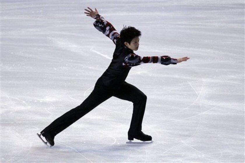 Takahiko Kozuka of Japan performs his Men Short program during the Ice Skating Bompard Trophy at Bercy arena in Paris, Friday, Nov. 26, 2010. (AP Photo/ Francois Mori)