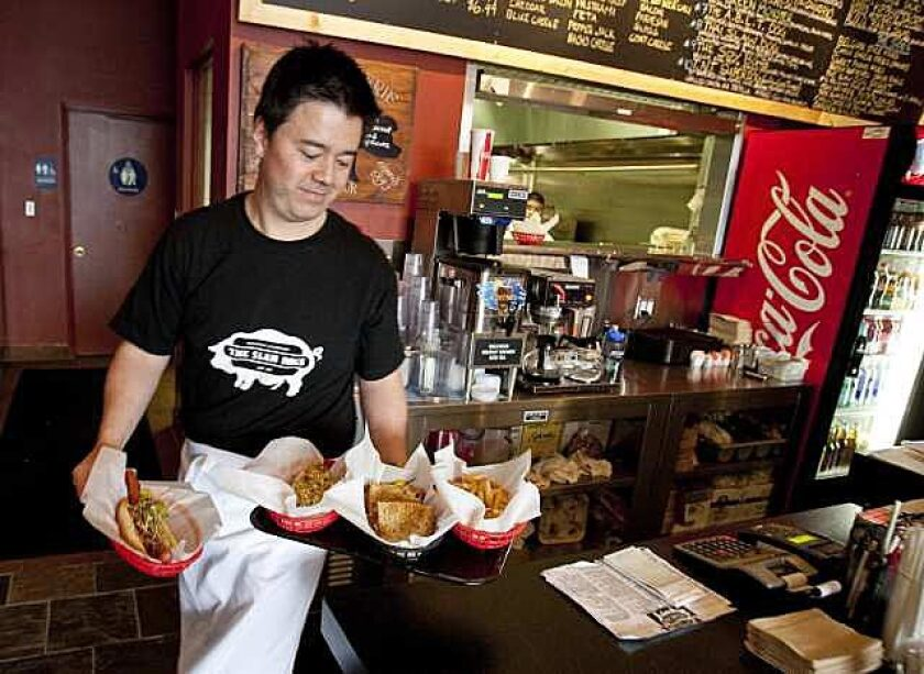 Slaw Dogs owner Ray Byrne serves up a few of his specialties.