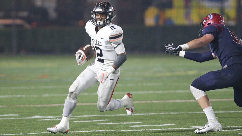 Huntington Beach running back Arick McLawyer runs around the defense in the first round of the CIF S
