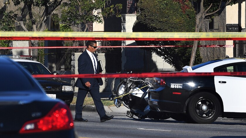 LAPD officials say a motorcycle officer shot and killed an 18-year-old, identified as Kenney Watkins, Tuesday afternoon following a traffic stop in South L.A.