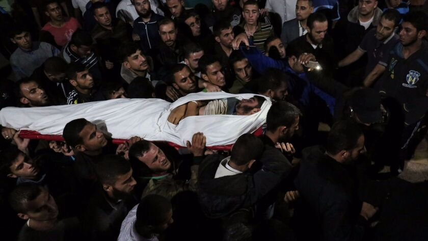 The body of Marwan Alagha, 22, is carried by mourners at Nasser hospital in Khan Yunis, in the southern Gaza Strip, on Oct. 30, 2017. He was killed when Israel blew up what it said was a tunnel stretching from the Gaza Strip into its territory.