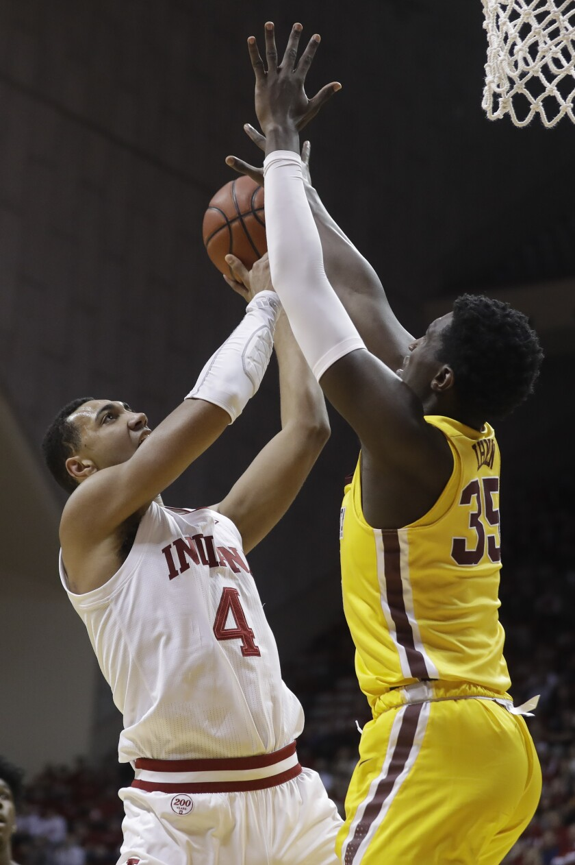 Indiana's Trayce Jackson-Davis (4) shoots against Minnesota's Isaiah Ihnen (35) during the first half of an NCAA college basketball game, Wednesday, March 4, 2020, in Bloomington, Ind. (AP Photo/Darron Cummings)