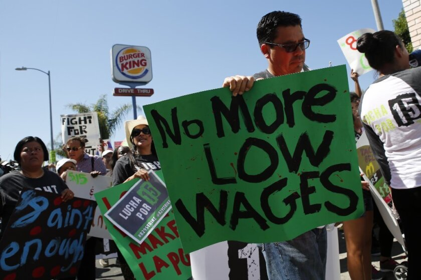 Fast-food workers and supporters organized by the Service Employees International Union protest outside a Burger King restaurant in Los Angeles on Aug. 29. Lawmakers in Sacramento have struck a deal to raise the state's minimum wage to $10 an hour.