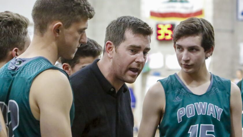 Poway basketball coach Scott Fisher (shown last season) has guided the Titans to a 15-4 record this season.