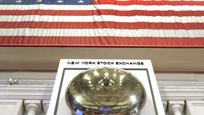 An American flag hangs above the bell podium on the floor of the New York Stock Exchange.