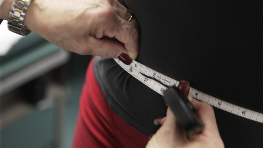 A waist is measured during an obesity prevention study at Rush University Medical Center in Chicago.