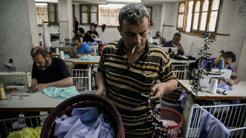 GAZA CITY, GAZA STRIP -- SATURDAY, MAY 12, 2018: Fayez Shubair, manages garment workers at the Nafez