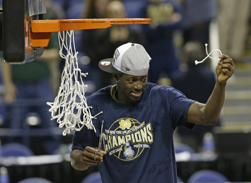 Notre Dame's Jerian Grant celebrates after an NCAA college basketball game against North Carolina in the championship of the Atlantic Coast Conference tournament in Greensboro, N.C., Saturday, March 14, 2015. Notre Dame won 90-82. (AP Photo/Gerry Broome)