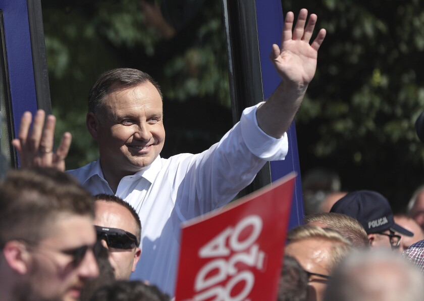 Polish President Andrzej Duda waves as he campaigns ahead of a presidential election later in this month, in Plonsk, Poland, on Tuesday June 16, 2020. Duda is ahead of nine other candidates, but he is not expected to get the 50% needed in the June 28 balloting to avoid a runoff. He is considered most likely to face off in a second round on July 12 against Warsaw mayor Rafal Trzaskowski.(AP Photo/Czarek Sokolowski)
