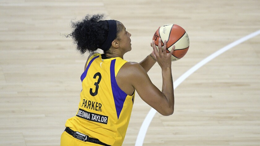 Sparks forward Candace Parker takes a shot.