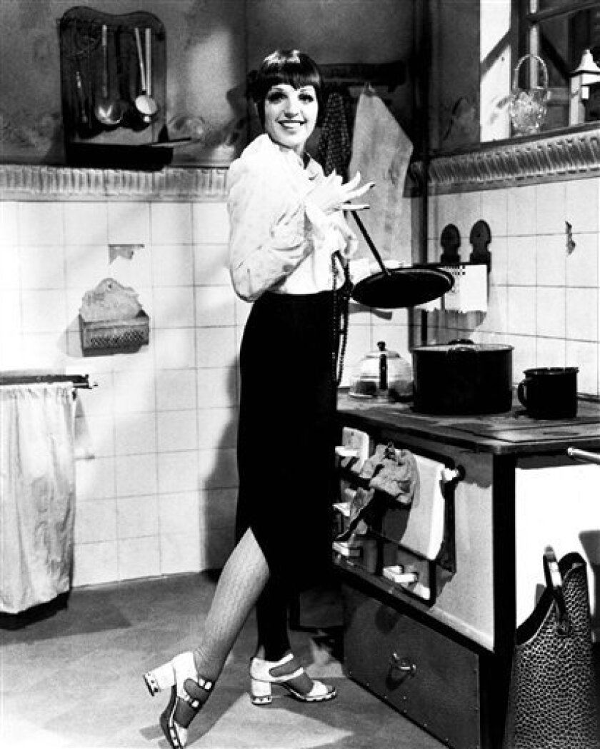 """FILE - This March 1972, file photo, shows actress Liza Minnelli in character in """"Cabaret."""" The restored """"Cabaret"""" is opening the TCM Classic Film Festival that runs Thursday, April 12, 2012, to Sunday in Los Angeles. Liza Minnelli and Joel Grey, the movie's stars, were scheduled to attend the ceremony marking the movie's 40th anniversary. (AP Photo/File)"""