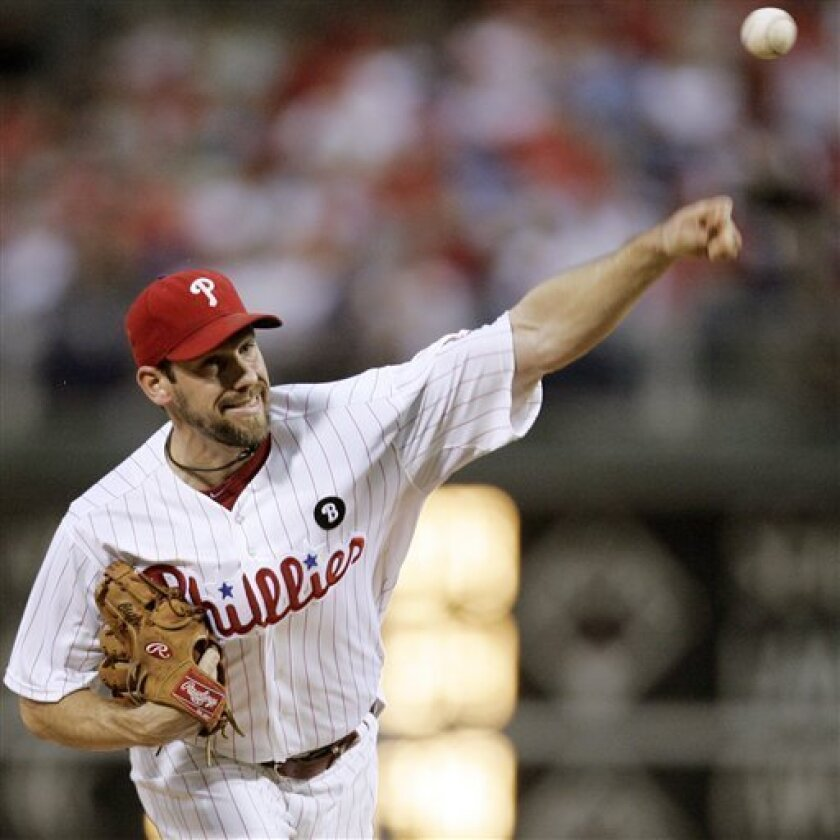 Philadelphia Phillies starting pitcher Cliff Lee throwing during the first inning of a baseball game with the Atlanta Braves, Monday, Sept. 5, 2011, in Philadelphia. (AP Photo/Tom Mihalek)
