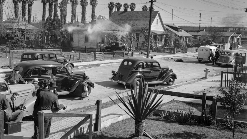 Feb. 17, 1938: Tear gas issues from a home in the 1700 block of East 22nd Street as police trade shots with barricaded suspect George Farley.