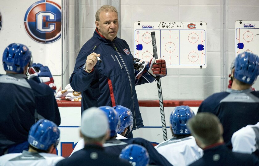 Montreal Canadiens head coach Michel Therrien gives instructions during NHL hockey practice Wednesday, April 30, 2014, in Brossard, Quebec. The Canadiens face the Boston Bruins in Game 1 in the second round of the Stanley Cup playoffs Thursday in Boston. (AP Photo/The Canadian Press, Paul Chiasson)