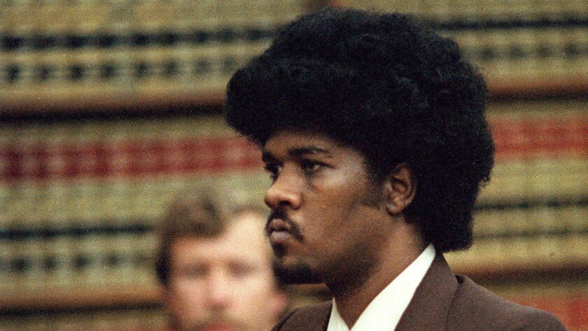May 15, 1985 file photo of convicted murder, Kevin Cooper, as he stands before the judge while being sentenced to death for the slayings of family from Chino.