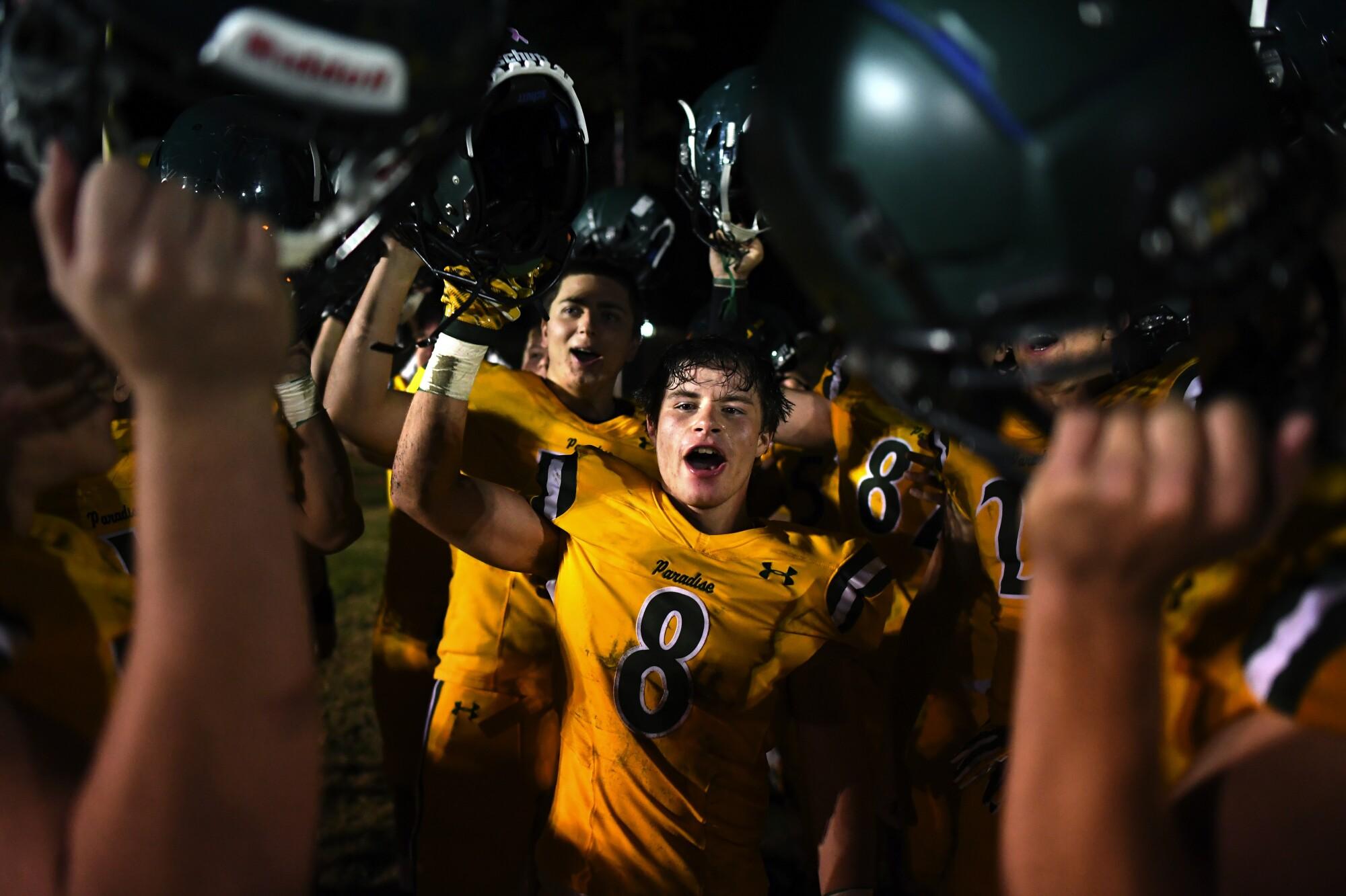 Paradise football player Brenden Moon celebrates with his teammates.