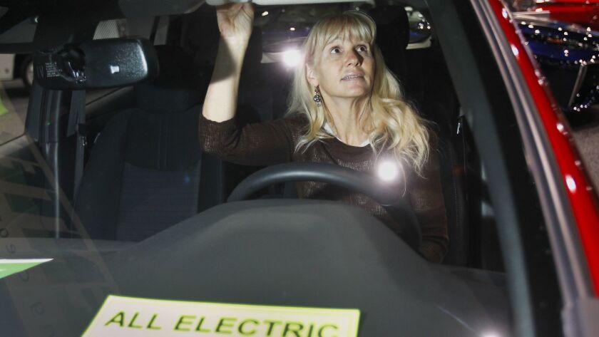 SAN DIEGO, December 29, 2018 | Cynthia Jackson looks at the interior of a 2019 Nissan Leaf SV all el
