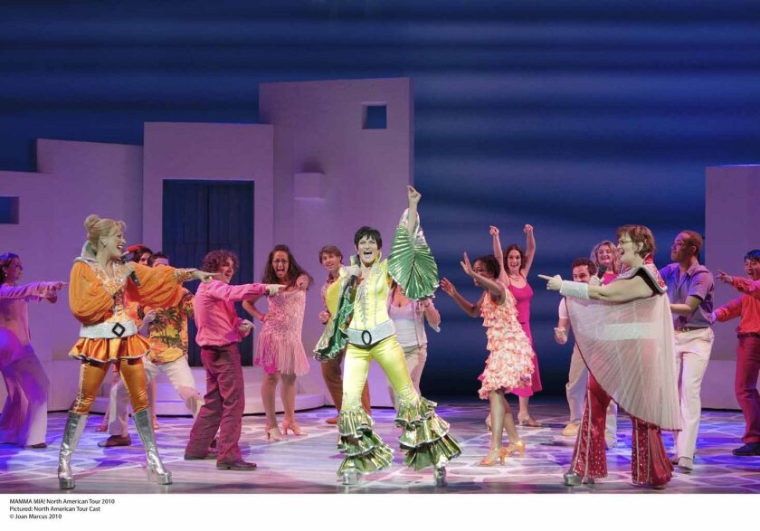 "Kaye Tuckerman (center, in green) leads the cast of ""Mamma Mia!,"" whose touring version is now at the Civic Theatre downtown."