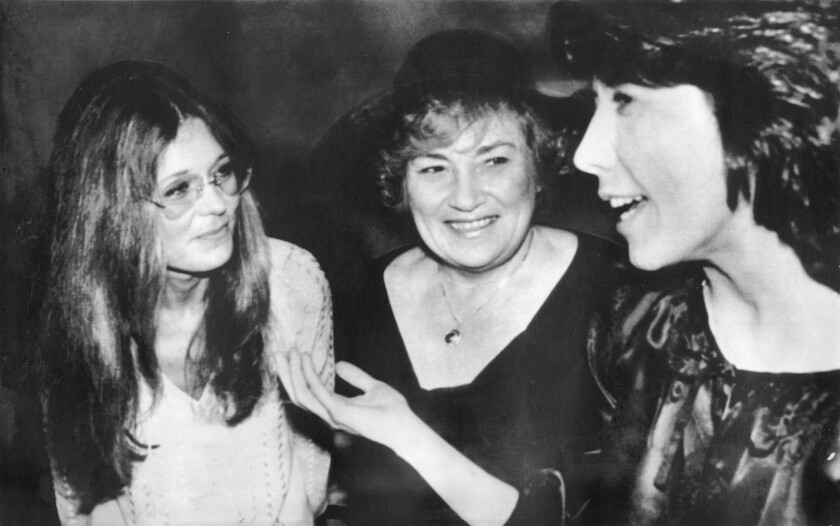 """Gloria Steinem, Bella Abzug and Lily Tomlin in New York City in 1977. In a satirical piece in 1978, Steinem wrote that if men had periods, """"menstruation would become an enviable, boast-worthy masculine event."""""""