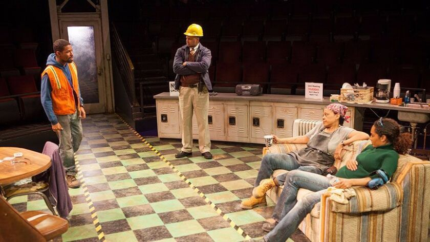 """Amari Cheatom as Dez, Brian Marable as Reggie, Tonye Patano as Faye, and Rachel Nicks as Shanita in Dominique Morisseau's """"Skeleton Crew,"""" directed by Delicia Turner Sonnenberg, in association with MOXIE Theatre, running through May 7 at The Old Globe."""