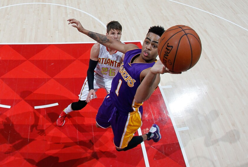 Lakers guard D'Angelo Russell shoots after getting behind the Hawks' Kyle Korver in Atlanta on Dec. 4, 2015.