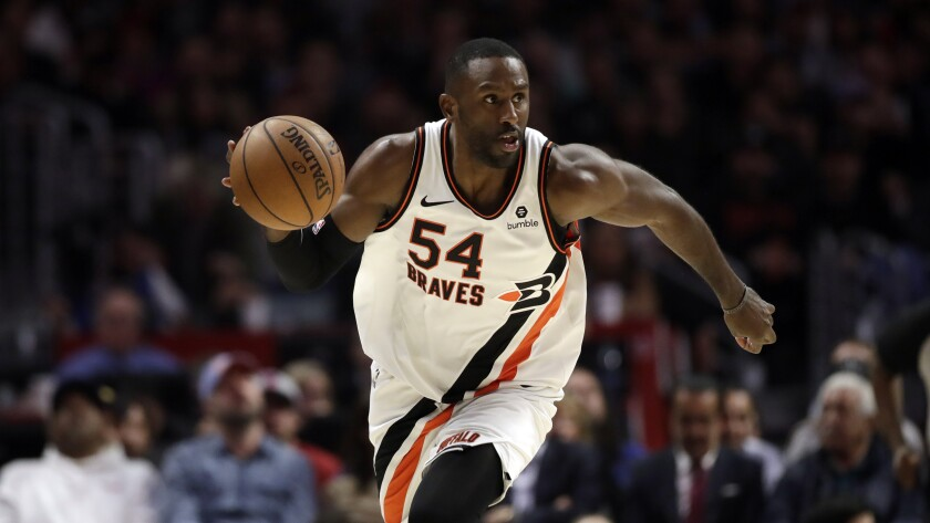 Clippers forward Patrick Patterson controls the ball during a game.